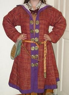 Hungarian female costume (circa 950 AD). The shirt is sewn Cordelet flax linen pendants are made of bronze (originally made of gold or silver). pants is Linen and silk thread combined. Caftan is The sheep wool (to Original sheep, goat or camel), the border is linen (sometimes silk). coat is made of wool with a cross in on-canvas, linen lining and trim (sometimes silk). It is decorated with bronze discs (the original Gold and Silver)
