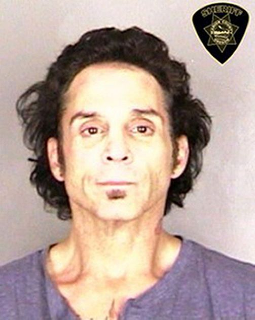In this handout photo provided by the Marion County Sheriffs Office, musician Deen Castronovo of Journey is seen in a police booking photo after his arrest on domestic violence allegations June 29, 2015 in Salem, Oregon. The charges against Castronovo include unlawful use of a weapon, menacing, rape, sexual abuse, assault, coercion and criminal mischief. #deencastronovo #journey #roboace #roboacescom