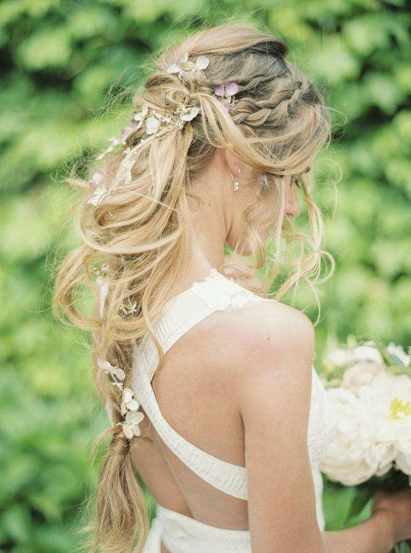 Messy, swooping braids boho wedding hairstyle