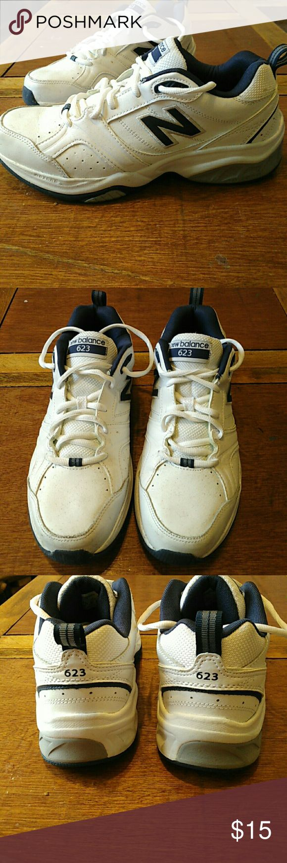 "New Balance 623 White tennis shoes with navy blue ""N"" on the sides and some grey detail on side of sole. Very good shoes and comfortable too! These have been worn once for a few hours, good condition. New Balance Shoes Sneakers"
