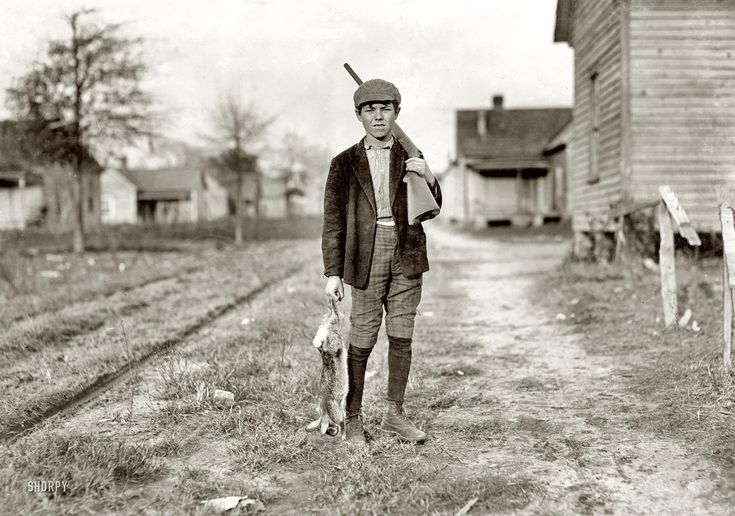 """December 1908. Dillon, South Carolina. """"Charley Baxley. Has doffed 4 years at Dillon Mills. Gets 50 cents a day. Had been out hunting."""" Photograph and caption by Lewis Wickes Hine."""