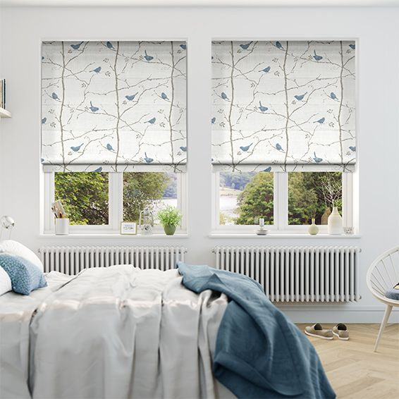 This Dawn Chorus Mineral Blue roman blind appeals to both young and old, with pale blue birds balancing on the branches of an ever-growing neutral tree.