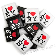 "I Love New York Milk Chocolate Squares Looking for an afforable gift symbolizing New York City? Milk chocolate I Love NY chocolates are the perfect gift for a party basket, wedding, birthday and corporate event. Easy to transport and delicious to eat, our officially licensed chocolates should be on your list. Comes in two wrapper colors - White & Black. Kosher product. Each I Love New York Chocolate Square measures 1.25""L x 1.25""W x .25""H Makes a great additional to a gift basket, table ..."