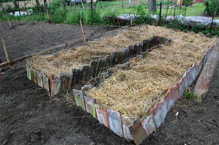 rasied bed using old roof tiles