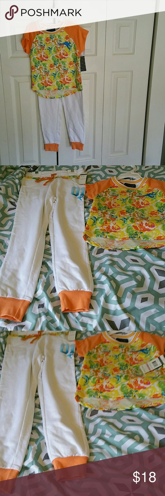 Coogi girls 2-piece sets Coogi girls size 5/6,6x  two piece sets.Floral top with back logo ,white pant  with elastic waistband and ankles,3 pockets.Great for active girls who love to run  and play.New with tags.This is from a smoke and pet-free home. COOGI Matching Sets