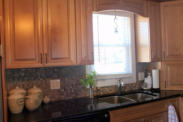 honey cabinets granite countertops cabinet along