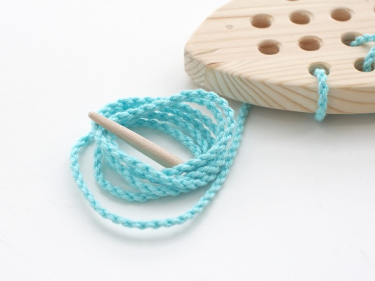 Wooden crafted Fish for kids to create first cross-stitch works. Material: pine or birch wood, cotton cord. By Nämä