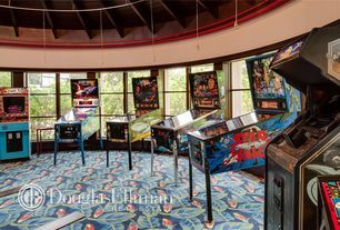 Eclectic Game Room with Carpet, Arcade games, Round room, Exposed ceiling rafters