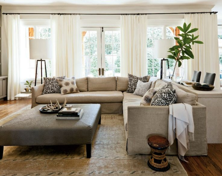 Burlap colored oversized sectional gives plenty of room for changing color schemes with pillows etc as time goes on