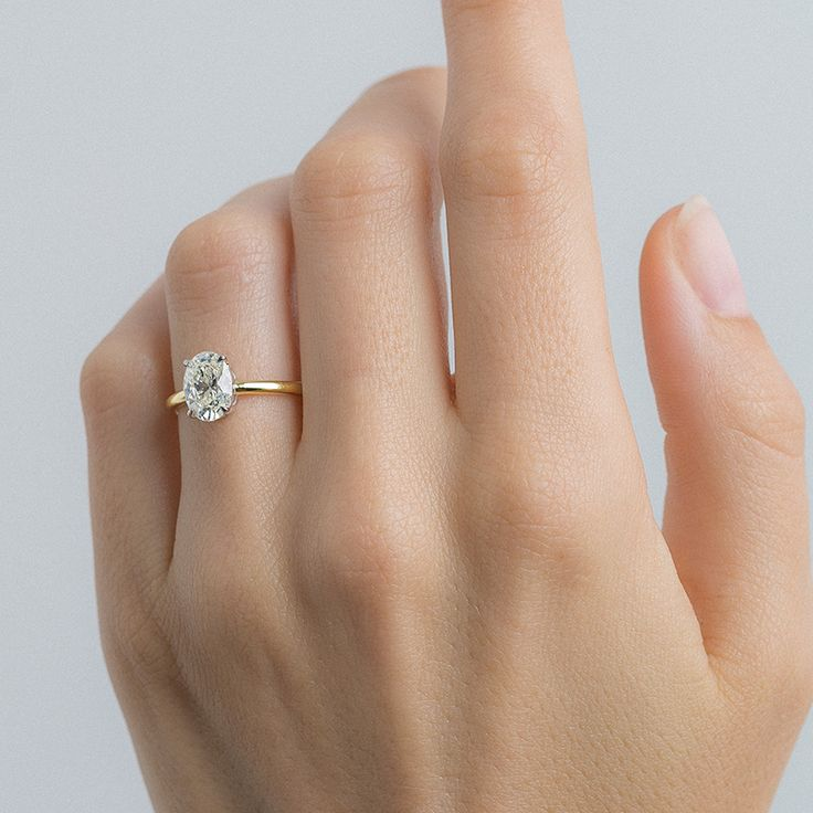Simple & minimal oval solitaire engagement ring // Tulum by Trumpet & Horn