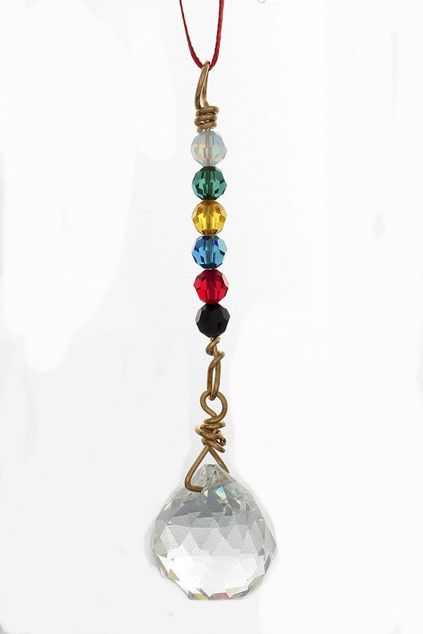 This is a small crystal to hang on the rear-view mirror. Before hanging it, bless it with protection and safety for all who ride in the car. This comes from the Black Hat Feng Shui tradition. Size: 20