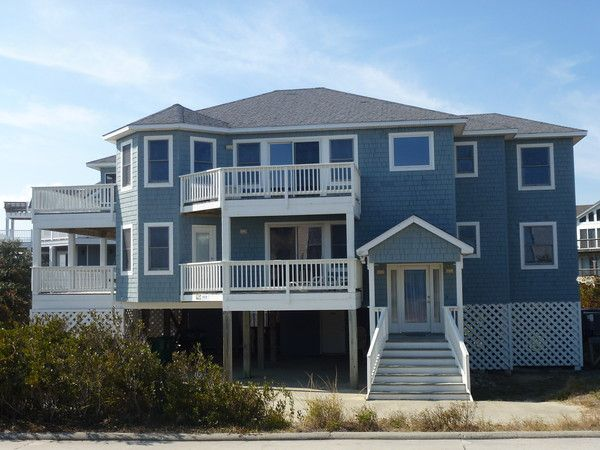 """""""Carolina Dunes"""" has everything you'll need for a memorable Corolla beach vacation. Wonderful ocean views will be enjoyed by all from this lovely pet friendly semi-oceanfront cottage. """"Carolina Dunes"""" is located on a quiet cul-de-sac and only fifty feet from the beach access in the popular community of Ocean Sands. Kid friendly amenities including a basketball goal, Pac N Play, high chair and video library make this home ideal for families. With four decks provi..."""