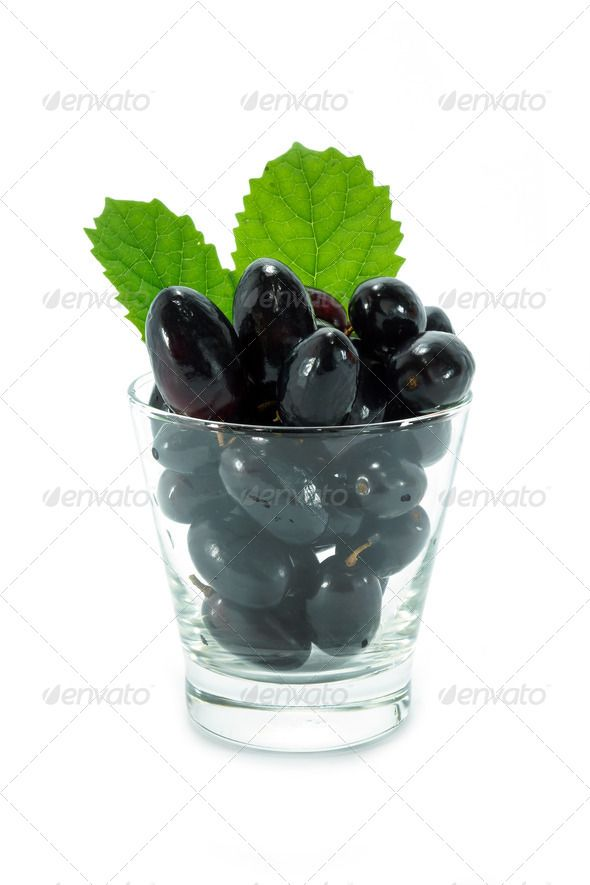 Black grapes in a glass isolated on a white background. ...  agriculture, background, berry, black, branch, brown, bunch, burgundy, cabernet, closeup, cluster, cork, dark, dessert, diet, element, food, fruit, glass, grape, grapevine, green, harvest, ingredient, isolated, juice, juicy, leaf, nutrition, object, raw, sprig, stopper, vine, vineyard, vino, viticulture, white, wicker, wine, winemaker, winery