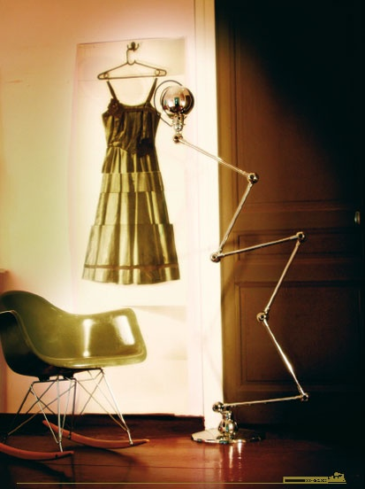 jielde loft collection lamp. love the deborah bowness wallpaper too. and the eames rocker. :)