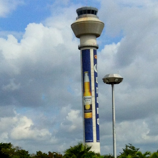 Is a corona really what you want advertised on the air traffic control tower governing the flight you are about to board in Cancun, MX?