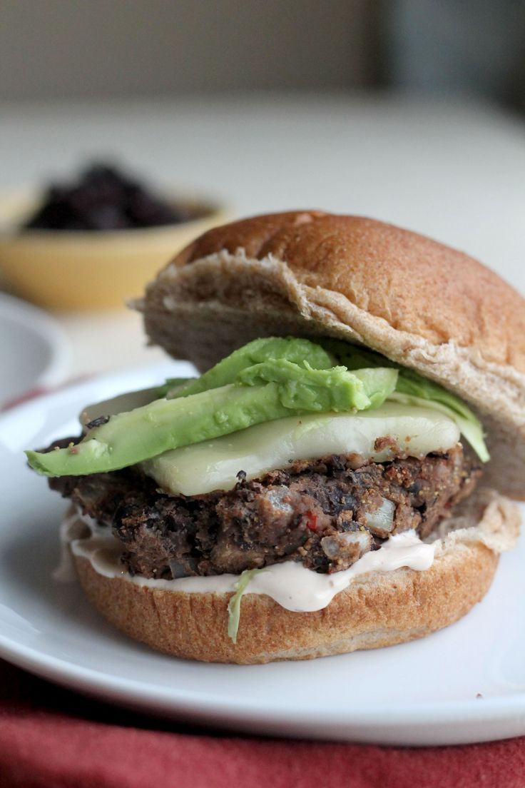 These Black Bean Burgers are full of flavor and topped with a chipotle mayo sauce, avocado, and Monterey Jack cheese
