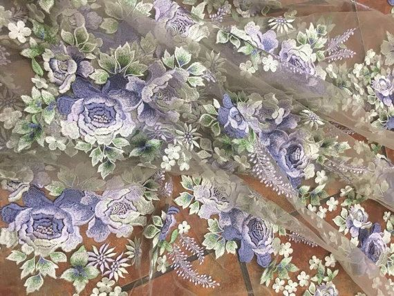 embroidered lace fabric with purple roses and green leaves