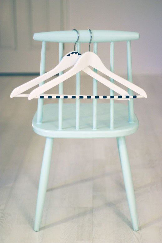 If you have an exposed closet or clothing rack, use colored tape to prettify your hangers.