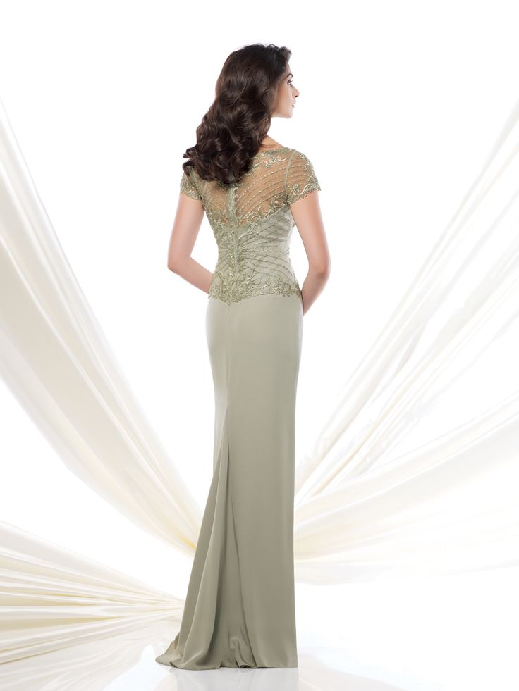 Silky crepe and tulle slim A-line gown with hand-beaded and embroidered illusion short sleeves, beaded illusion bateau neckline with embroidered scroll motif over sweetheart bodice with matching illusion back, sweep train, suitable for the mother of the bride and the mother of the groom. Embellish by David Tutera earring style Juliana sold separately. Sizes: 4 …