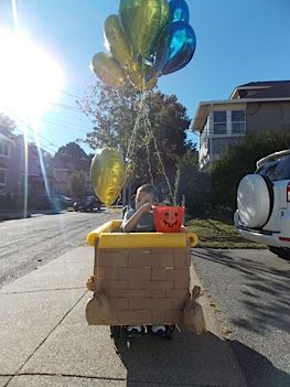 Here's a fun idea for Halloween - how about transforming your child's wheelchair into a hot air balloon? All you need is some foam board and cardboard strips to make your basket!