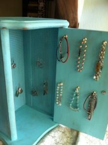 Repurposed bread box is now a jewelry cabinet!  DuctTapeAndDenim.com