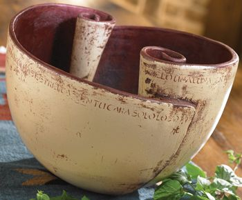 Mother Earth Legend Bowl. A legend in its own right, this handcrafted clay bowl's unusual scrolled design is certain to be the source of many a conversation as to its origin and meaning.