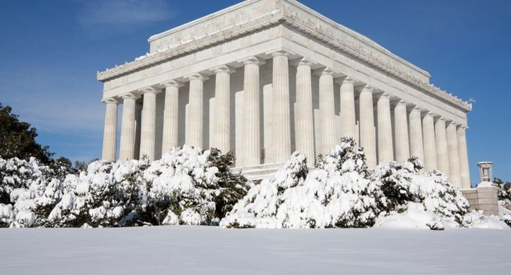 The Lincoln Memorial seemingly rises from the snow on a winter day in DC.