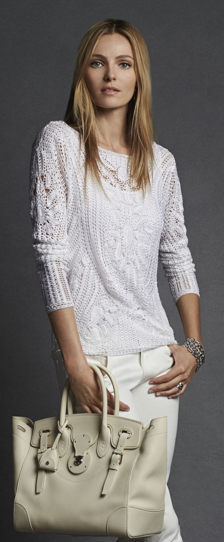 This ultra-soft white Ralph Lauren sweater is hand-crocheted and features a feminine bateau neckline