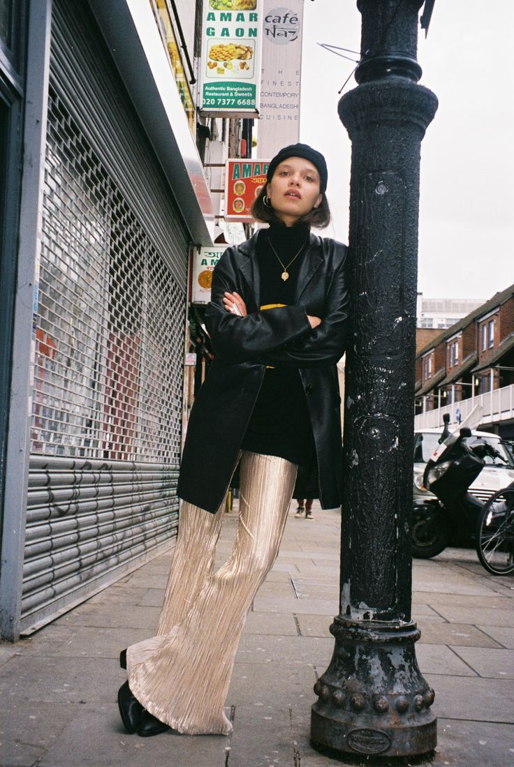 Stella wears our brand new Solid Gold Lame Flare Pants available online now loversanddrifters.com