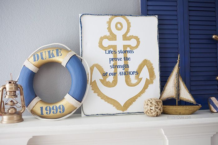 Nautical mantel with anchor sign, life preserver ring and wood sailboat.