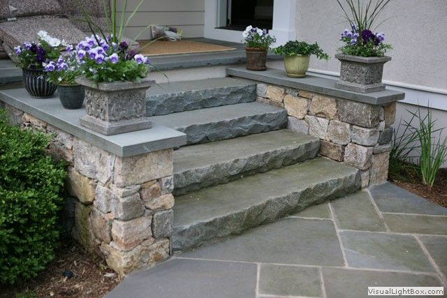 Bluestone risers with granite cheek walls. Would have been nice to carry the rockfacing through on the wall caps...
