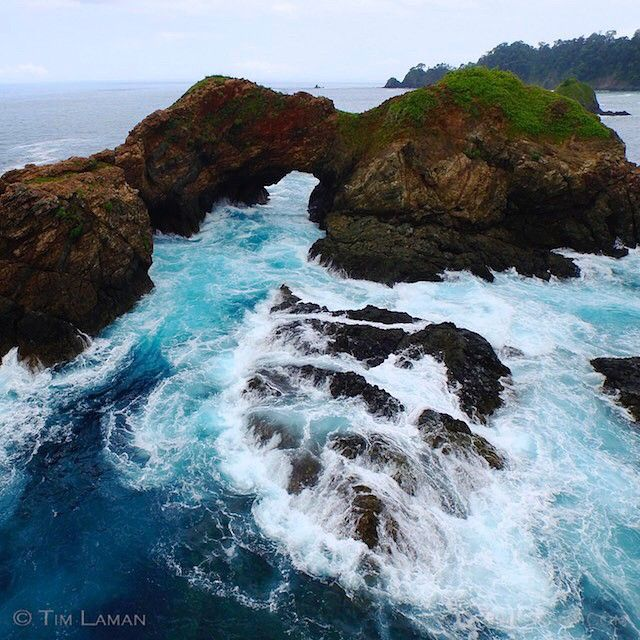 Waves crash over the rocks and surge through a natural arch near Punta Hermosa on the Pacific side of Coiba Island, Panama.  See more Coiba marine life photos @TimLaman. Together with my colleague @ChristianZiegler, I am working on a photo essay to celebrate Coiba National Park and its amazing biodiversity.  #Coiba, #Panama, #conservation, @thephotosociety, @iLCP_photographers, @natgeocreative, @TimLaman.