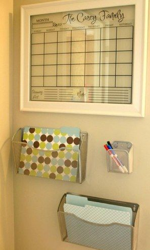 I like this window pane family calendar, along with the wall pockets. Great in a high traffic area.