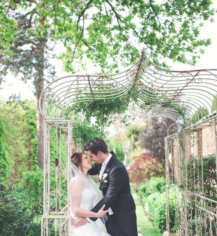 Bride groom kiss wedding photography