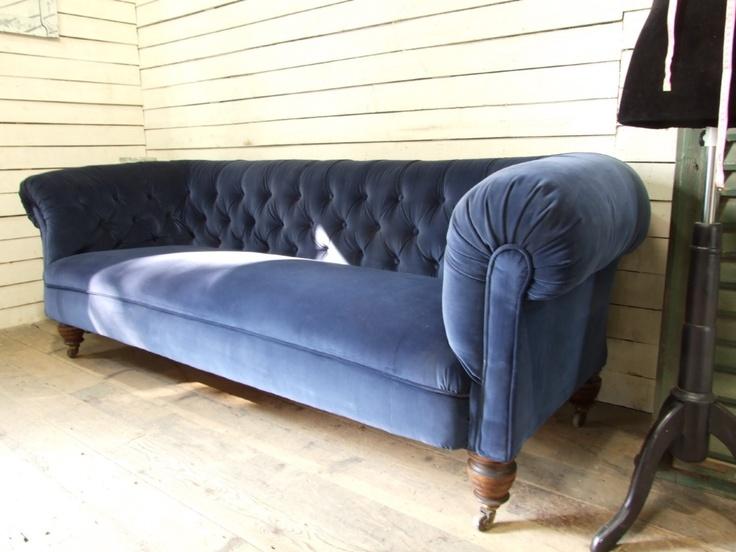 hereu0027s a blue velvet sofa