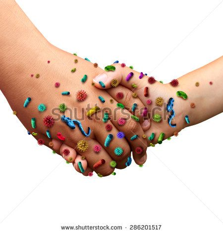 Infectious diseases spread hygiene symbol as people holding hands with germ virus and bacteria spreading with illness as a health care risk concept for not washing hands as contagious pathogens. - stock photo