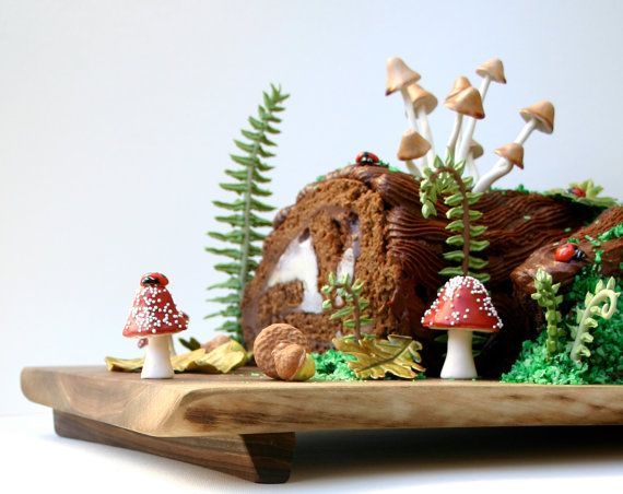 Woodland Cake Decorating Set, comes with edible wild sugar mushrooms of the genus Psilocybe Cubensis, chocolate-filled red toadstools, edible sugar ferns and fiddle heads, edible sugar woodland foliage, chocolate cocoa bean-filled candy acorns, and edible sugar lady bugs. $104.60 on Etsy.