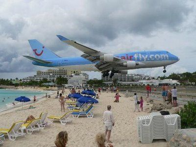 Maho Beach, St Maartenm, Netherlands Antilles! The runway is positioned yards near the beach & beach bar! Definately a must see for my bucket list!