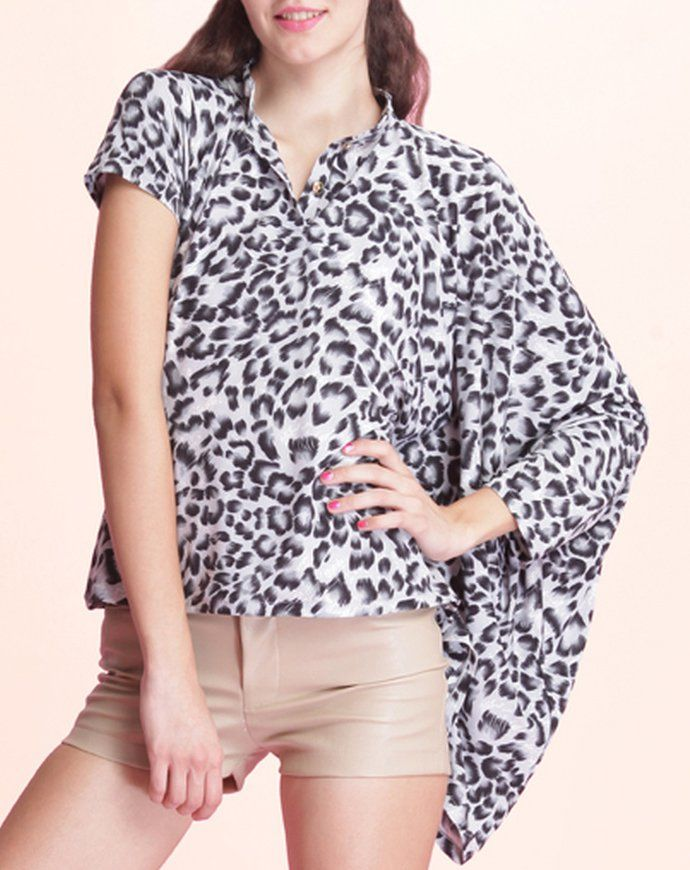 Andrea Top by Wearbunch. Unique all the way. This leoparad pattern shirt has a short sleeves and the other is a dolman sleeve. If you want to be notice, make sure this top is in your collection. made from spandex fabric. http://zocko.it/LD4Jw