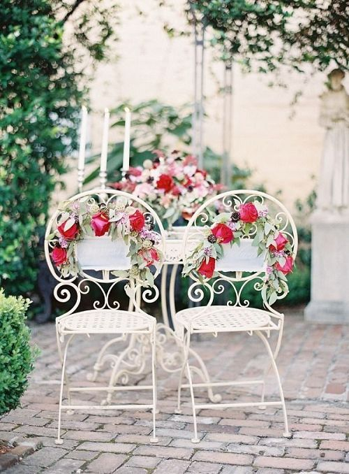 Rose-Decorated Iron Cafe Wedding Chairs / http://www.deerpearlflowers.com/30-chair-decor-ideas-with-florals-for-springsummer-weddings/
