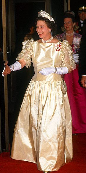Queen Elizabeth wearing the kokoshnic with a pale lemon gown, possibly Gina Fratini in design.
