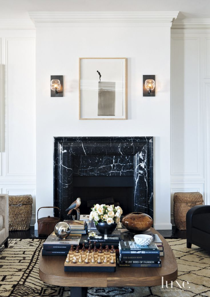 Transitional White Living Room with Black Marble Fireplace