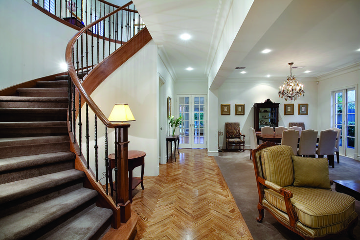 Curved Staircase With Dark Carpet Finish And Stained Handrail To Create Contrast.  Ravida- Property With Distinction