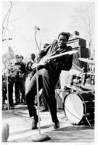 Buddy Guy ...letting it rip. Great old black and white photo. I remember seeing Buddy back in the 70's wearing a 3-piece RED suit. He was classic.
