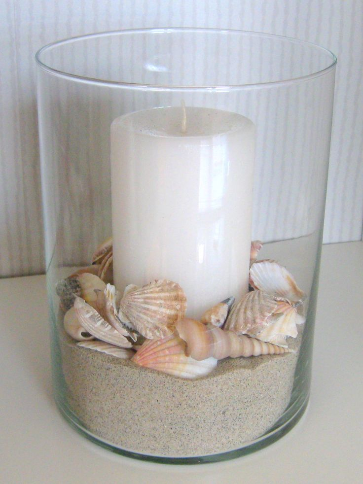 DIY decor for our beach home. Hurricane lamp bought at Walmart, shells bought at The Dollar Tree and sand from the beach - viola!