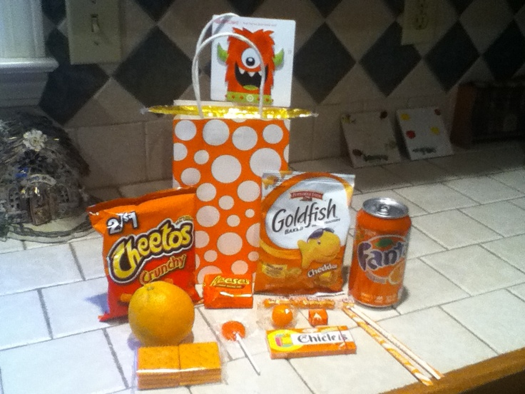 Teacher gift for end of year. Orange you glad it is summer ?!  I filled the bag with orange snacks and an orange Target gift card. Tied up with orange slice tag and ribbon.