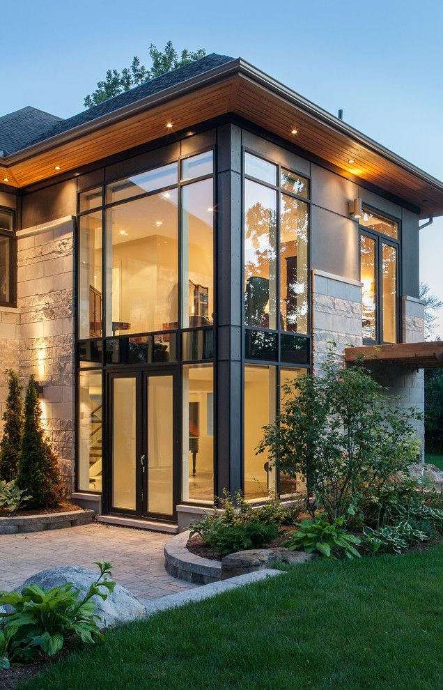 Straight Lines....Large Long Windows...Such a Modern Home...yet with the black trim it looks cozy and warm.