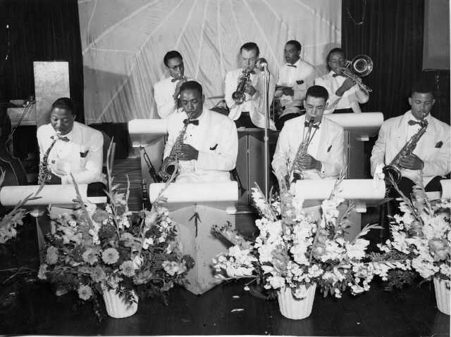 The club band included Local 117 member Meltarrus (Mel) Washington (front row, second from left) on saxophone. Mr. Washington was Drum Major for the 21st Army at Fort Lewis and played in the first integrated jazz band at the base. After retiring from the army in 1962, he settled near Fort Lewis. He formed his own jazz group, The Mel Washington Trio, and taught music for the Tacoma Public School District.
