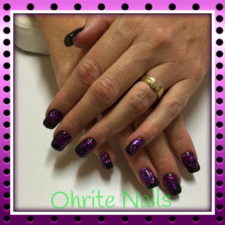 Black gel nails with purple glitter fade.