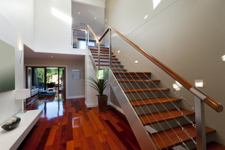 Kim stairs Two-story modern home entrance foyer with wood floor and straight wood and metal staircase http://www.homestratosphere.com/entrance-foyer-design-ideas/